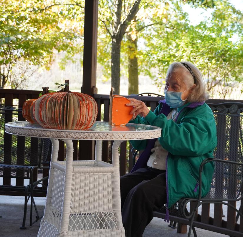 Phyllis enjoys outdoor crafts in the Gazebo